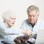 Elderly Couple Doing Paperwork